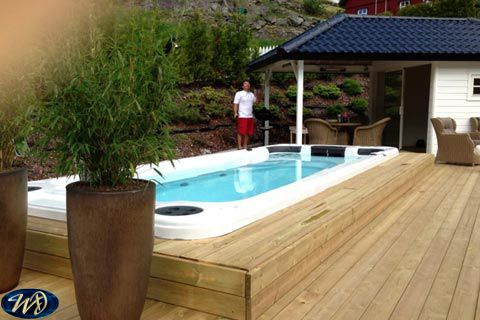 Swimspa Aquatic 2 outdoor installation with man