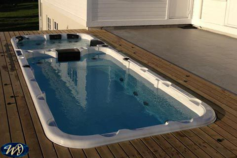 Swimspa Aquatic 3 on a raised level sunk in decking